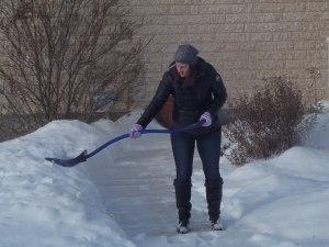 Crystal shovelling the neighbour's sidewalk...