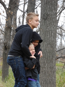 boys standing on a stump...