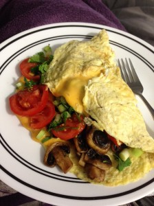 lovely omelet with mushrooms, green onions, my tomatoes, and cilantro...