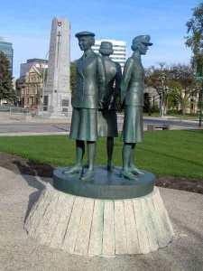 statue of women in the three services at the Manitoba Legislature building...